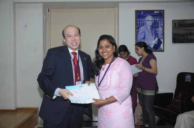 Ms. Preshita Desai receiving award for 'Best Poster' from Prof. Rodney Ho