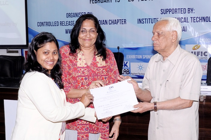 Ms. Preshita Desai receiving Best Poster award from Prof. H. L. Bhalla