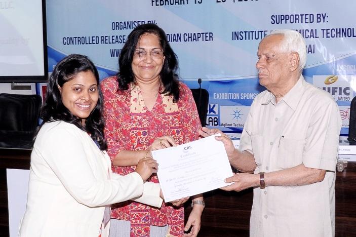 Ms. Preshita Desai receiving Best Poster award from Prof. H. L. Bhalla